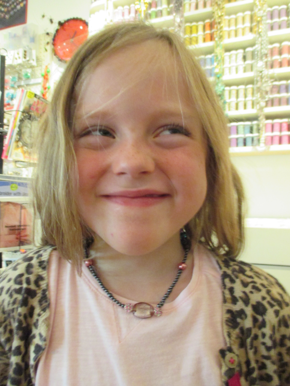 smiling girl with necklace