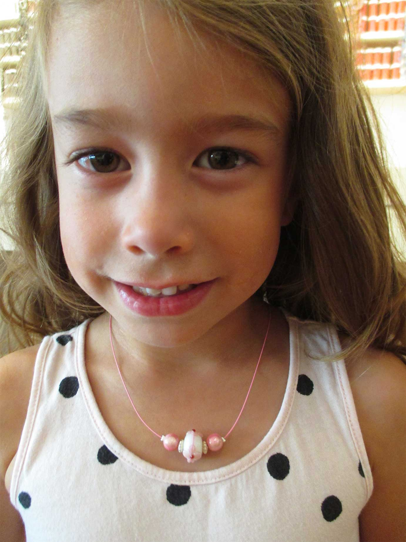 Girl wearing necklace